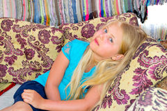 Girl sitting on the couch Stock Photography