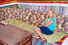 Girl sitting on the couch Royalty Free Stock Photography