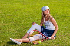 Girl sitting on the court Stock Photo