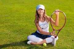 Girl sitting on the court Royalty Free Stock Images