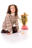 Girl sitting in a cozy sweater and boots Royalty Free Stock Images