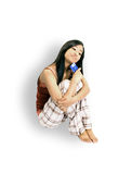Girl Sitting With A Credit Card. White background Royalty Free Stock Photos