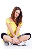 Girl sitting with crossed legs Stock Photography