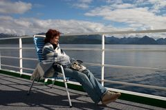Girl sitting on the cruise liner deck Stock Photo