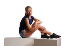 Girl sitting on cubes Royalty Free Stock Image