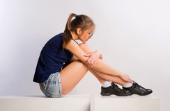 Girl sitting on cubes Stock Image