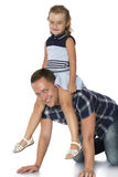 Girl sitting on dad's neck Stock Photo