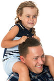 Girl sitting on dad's neck Royalty Free Stock Image