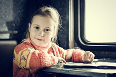 The girl sitting at a desk Royalty Free Stock Photo