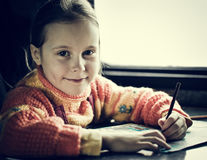 The girl sitting at a desk Stock Photos