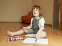 Girl sitting   and drawing. Stock Photos