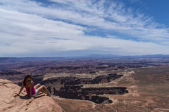 Girl sitting at the edge of the Canyon Stock Photo
