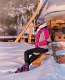 Girl sitting on edge of lake Stock Photography