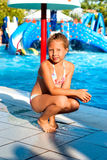 Girl sitting on the edge of the pool Royalty Free Stock Photography