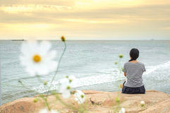 Girl sitting enjoy ocean Royalty Free Stock Photography