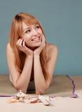 Girl sitting on fake beach Royalty Free Stock Image
