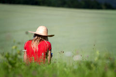 Girl sitting in a field Stock Photos
