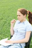The girl sitting in the field Stock Photos