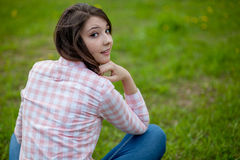 Girl sitting on the field Stock Images