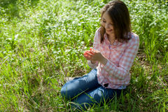 Girl sitting on the field Stock Photos