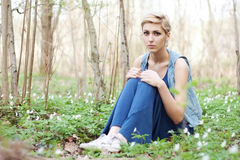 Girl is sitting in field of flowers Stock Photo