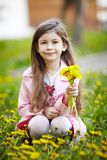 Girl sitting in field of flowers Royalty Free Stock Photos