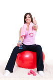 Girl sitting on a fitness ball Royalty Free Stock Images