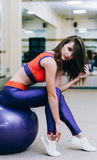 Girl sitting on a fitness ball royalty free stock image