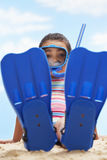 Girl Sitting In Flippers And Snorkeling Mask Stock Photo