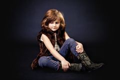 Girl sitting on the floor Stock Images