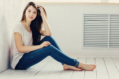Girl sitting on the floor. Beautiful girl sitting on the floor Royalty Free Stock Images