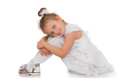 Girl sitting on the floor Royalty Free Stock Images