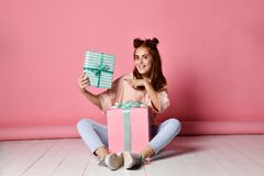 Girl sitting floor birthday gifts royalty free stock images