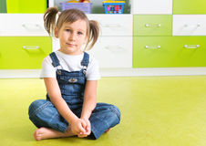 Girl sitting on floor Stock Photos
