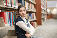Girl sitting on the floor holding book Stock Photography