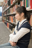 Girl sitting on the floor holding book Stock Photos