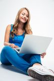 Girl sitting on the floor with laptop Stock Photo