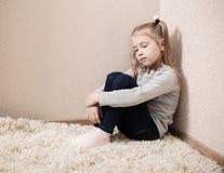 Girl sitting on the floor Stock Photography