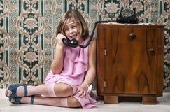 Girl sitting and make phone calls Stock Image