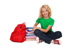 Girl sitting on the floor near books and bag Stock Photography