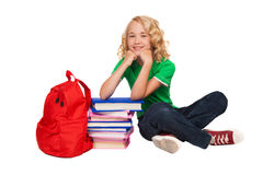 Girl sitting on the floor near books and bag Stock Photo