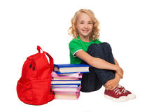 Girl sitting on the floor near books and bag Royalty Free Stock Photo