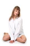 Girl sitting on floor over white Stock Photos