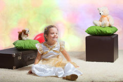 Girl sitting on the floor Stock Image