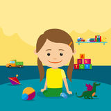 Girl sitting on floor with toys Stock Photo