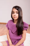 Girl sitting on the floor. Wearing sweater and socks Stock Image