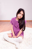 Girl sitting on the floor. Wearing weater and socks Stock Photo