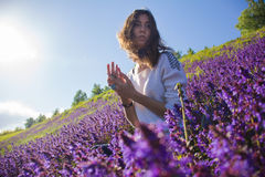 Girl sitting on a flower meadow Royalty Free Stock Photos