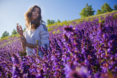 Girl sitting on a flower meadow Royalty Free Stock Images