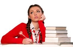 Girl sitting in front of books Stock Photography